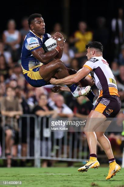 Maika Sivo of the Eels is tackled as he catches a kick by Herbie Farnworth of the Broncos during the round seven NRL match between the Parramatta...