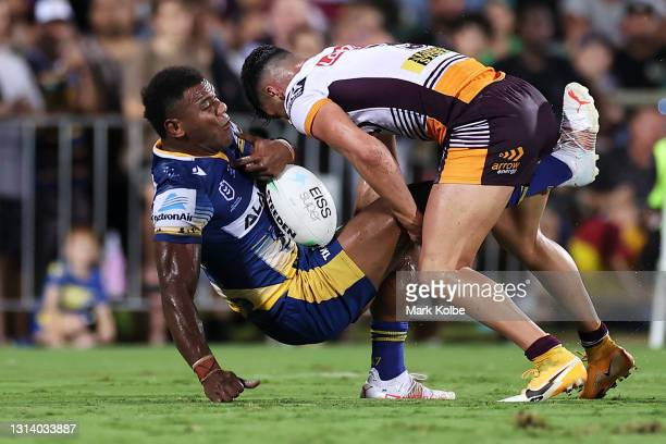 Maika Sivo of the Eels is tackled by Herbie Farnworth of the Broncos during the round seven NRL match between the Parramatta Eels and the Brisbane...