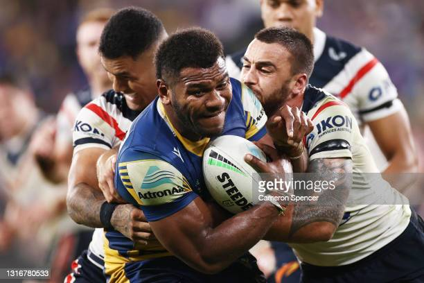 Maika Sivo of the Eels is tackled during the round nine NRL match between the Parramatta Eels and the Sydney Roosters at Bankwest Stadium on May 07...
