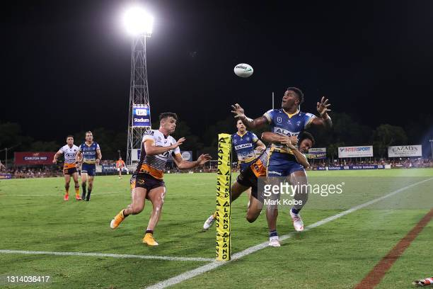 Maika Sivo of the Eels throws a hail mary passs as he is tackled during the round seven NRL match between the Parramatta Eels and the Brisbane...