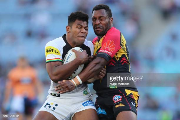 Maika Sivo of the Panthers is tackled during the 2017 State Championship Final between the Penrith Panthers and Papua New Guinea Hunters at ANZ...