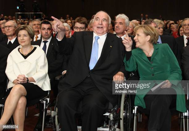 Maike KohlRichter former German Chancellor Helmut Kohl and German Chancellor Angela Merkel smile during an official birthday reception to former...