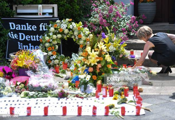 Maike KohlRichter widow of former German Chancellor Helmut Kohl kneels down in front of a makeshift memorial of candles and flowers in front of their...