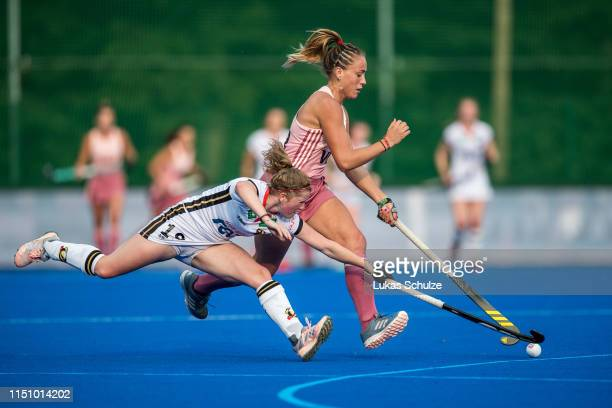 Maike Schaunig of Germany challenges for the ball with Julieta Jankunas of Argentina during the Women's FIH Field Hockey Pro League match between...