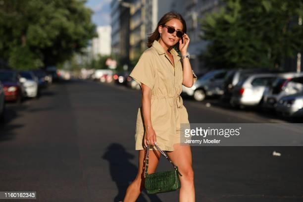 Maike Schmitz wearing a Rayban sunglasses via Sunglass Hut and Isabel Marant boots on July 01, 2019 in Berlin, Germany.