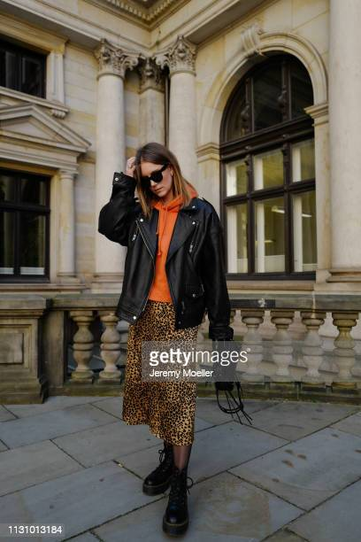 Maike Schmitz wearing Dr Martens shoes Leo dress from Otherstories Acne Studios hoodie Asos leather jacket Earrings Pilgrim Balenciaga bag on...