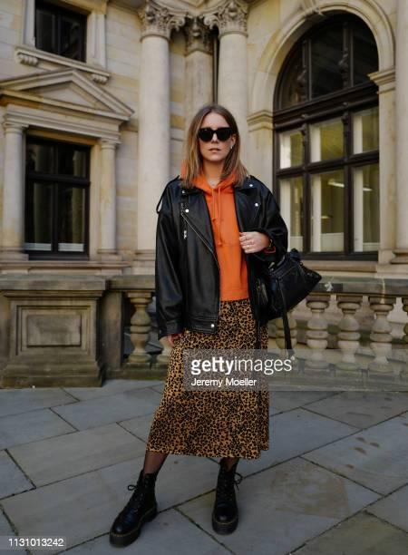Maike Schmitz wearing Dr. Martens shoes, Leo dress from &Otherstories, Acne Studios hoodie, Asos leather jacket, Earrings Pilgrim, Balenciaga bag on...
