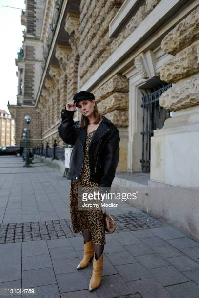 Maike Schmitz wearing Isabel Markant shoes, Leo dress &otherstories, Asos leather jacket, Earrings Pilgrim, Aigner bag on February 18, 2019 in...