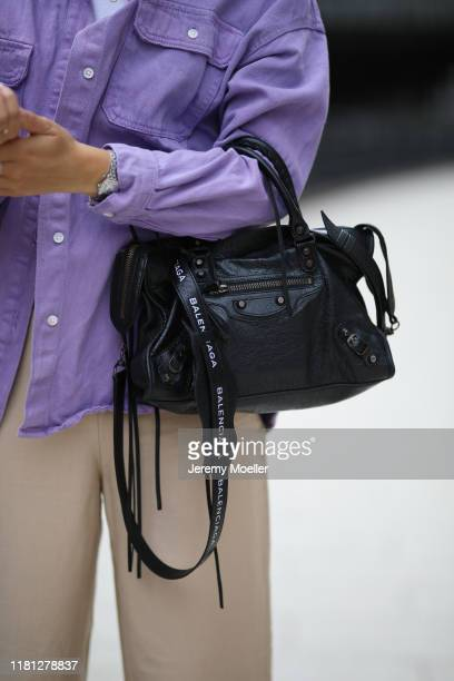 Maike Schmitz wearing Pull Bear shirt ivyoak top Ariane Ernst jewelry Other Stories pants and Balenciaga bag on October 14 2019 in Hamburg Germany