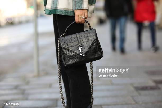 Maike Schmitz wearing Zara shoes and flannel Closed shirt Levi's Ribcage jeans YSL bag and Ariane Ernst chain wearing on December 15 2019 in Hamburg...