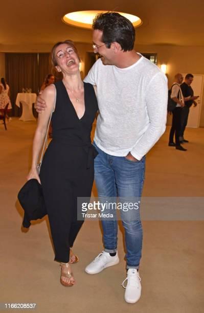 Maike von Bremen and Andreas Elsholz attend the 'Zuhause bin ich Darling' theater premiere at Komoedie am Kurfuerstendamm im SchillerTheater on...