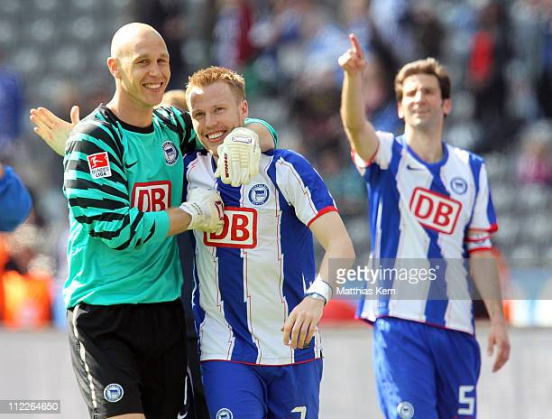 Maikel Aerts Christian Lell and Andre Mijatovic of Berlin are seen after winning the Second Bundesliga match between Hertha BSC Berlin and VFL...