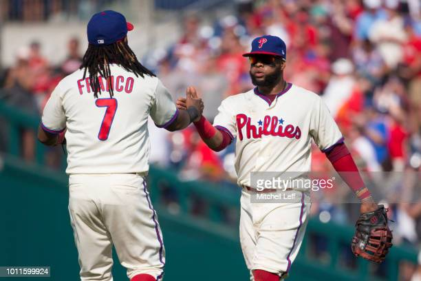 Maikel Franco and Carlos Santana of the Philadelphia Phillies celebrate after the game against the Miami Marlins at Citizens Bank Park on August 5...