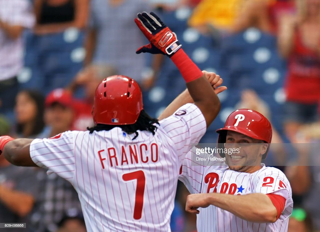 Maikel Franco #7 and Daniel Nava #25 of the Philadelphia Phillies celebrate Franco's two-run home run in the first inning against the Pittsburgh Pirates at Citizens Bank Park on July 5, 2017 in Philadelphia, Pennsylvania.