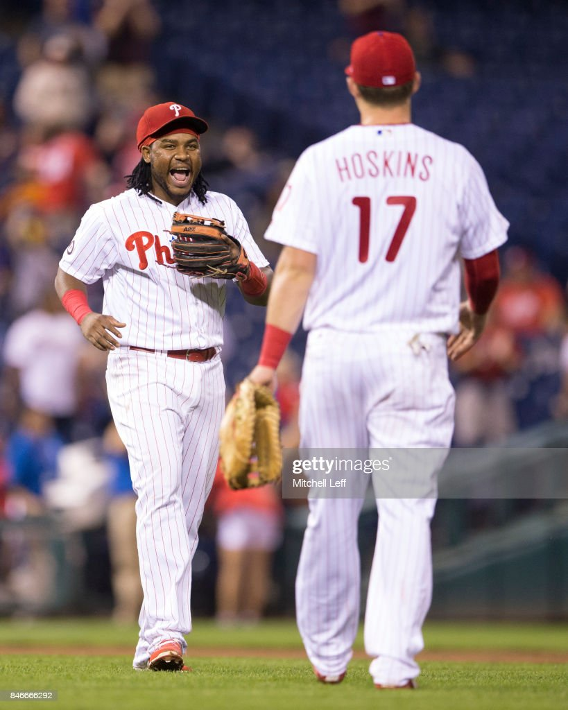 Maikel Franco #7 and Rhys Hoskins #17 of the Philadelphia Phillies celebrate at the end of the game against the Miami Marlins at Citizens Bank Park on September 13, 2017 in Philadelphia, Pennsylvania. The Phillies defeated the Marlins 8-1.
