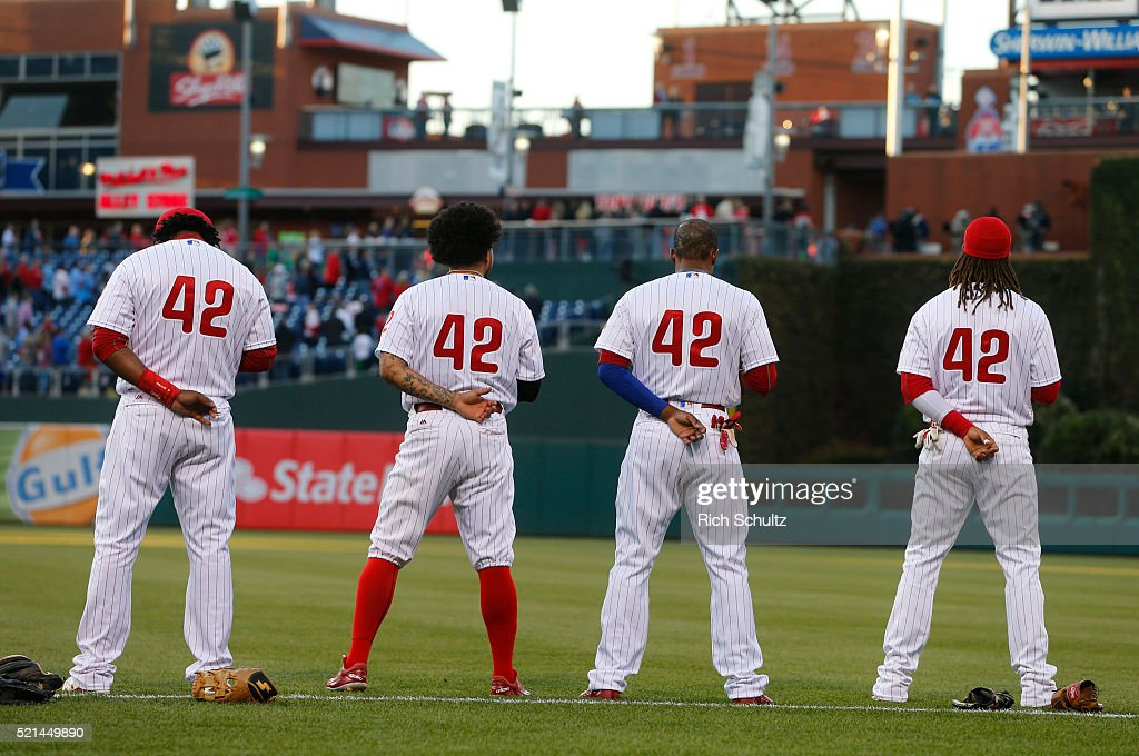 Maikel Franco, Freddy Galvis, Cedric Hunter and Emmanuel Burriss, (l-r) of the Philadelphia Phillies line up for the national anthem before an MLB game against the Washington Nationals at Citizens Bank Park on April 15, 2016 in Philadelphia, Pennsylvania. All players are wearing #42 in honor of Jackie Robinson.