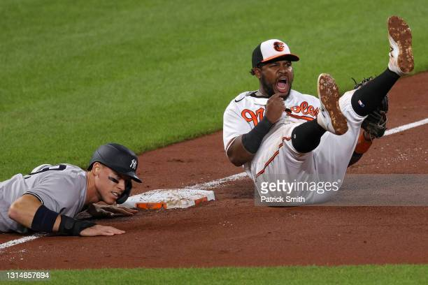 Maikel Franco of the Baltimore Orioles celebrates after Aaron Judge of the New York Yankees was thrown out at third base during the eighth inning at...