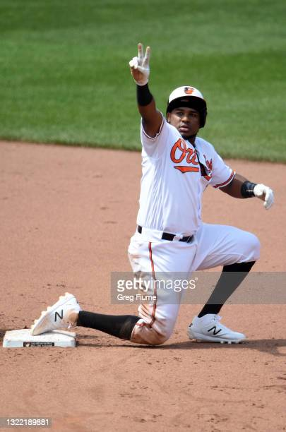 Maikel Franco of the Baltimore Orioles celebrates after hitting a double in the fourth inning against the Cleveland Indians at Oriole Park at Camden...
