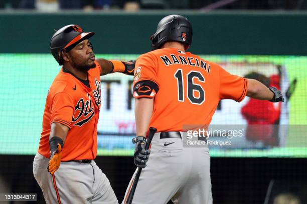 Maikel Franco of the Baltimore Orioles celebrates with teammate Trey Mancini after Franco hit a two-run home run in the ninth inning against the...
