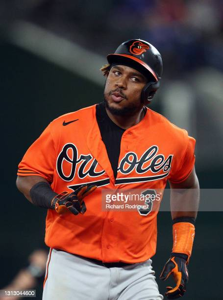 Maikel Franco of the Baltimore Orioles gestures to the Orioles dugout as he runs the bases on his two-run home run against the Texas Rangers in the...