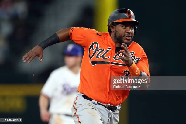 Maikel Franco of the Baltimore Orioles runs to third on a double by Trey Mancini in the eighth inning of the MLB game against the Texas Rangers at...