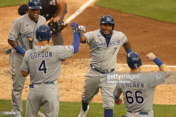 Maikel Franco of the Kansas City Royals celebrates his fourth inning two run home run and second of the game with Alex Gordon, Salvador Perez and...