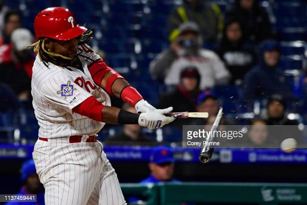 Maikel Franco of the Philadelphia Phillies breaks his bat on a hit during the tenth inning at Citizens Bank Park on April 15 2019 in Philadelphia...