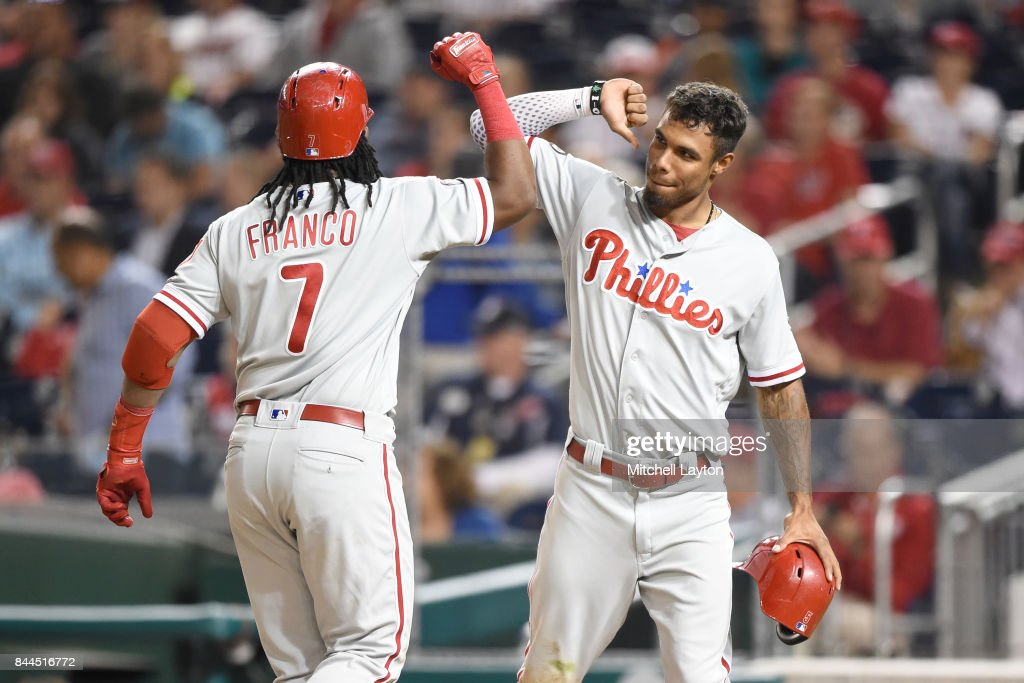 Maikel Franco #7 of the Philadelphia Phillies celebrates a three run home run with Nick Williams #5 int he ninth inning during a baseball game against the Washington Nationals at Nationals Park on September 8, 2017 in Washington, DC.
