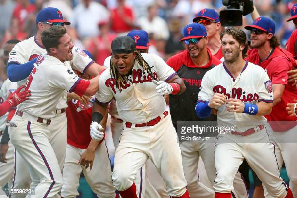 Maikel Franco of the Philadelphia Phillies celebrates with Andrew Knapp, Vince Velasquez, Bryce Harper and Aaron Nola after hitting the game winning...