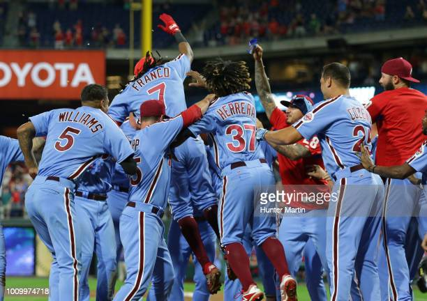 Maikel Franco of the Philadelphia Phillies celebrates with teammates after hitting a game winning walkoff threerun home run in the ninth inning...