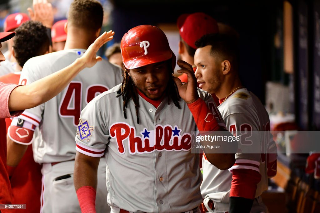 Maikel Franco #7 of the Philadelphia Phillies celebrates with teammates after scoring during the eighth inning in a win over the Tampa Bay Rays on April 15, 2018 at Tropicana Field in St Petersburg, Florida. All players are wearing #42 in honor of Jackie Robinson Day.