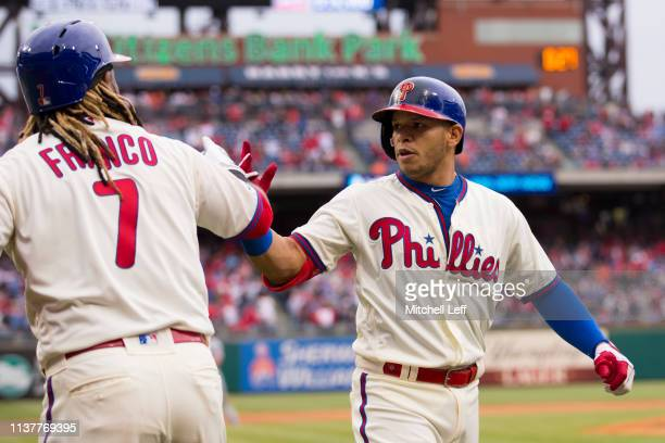 Maikel Franco of the Philadelphia Phillies congratulates Cesar Hernandez after his solo home run in the bottom of the sixth inning against the New...