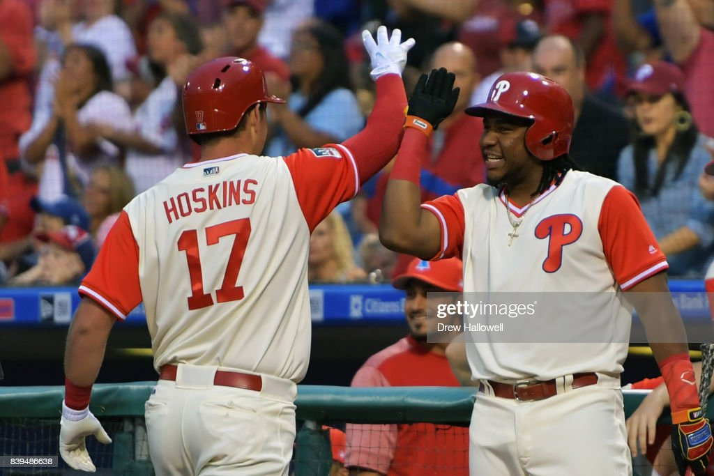 Maikel Franco #7 of the Philadelphia Phillies congratulates teammate Rhys Hoskins #17 on a two run home run in the first inning against the Chicago Cubs at Citizens Bank Park on August 25, 2017 in Philadelphia, Pennsylvania.