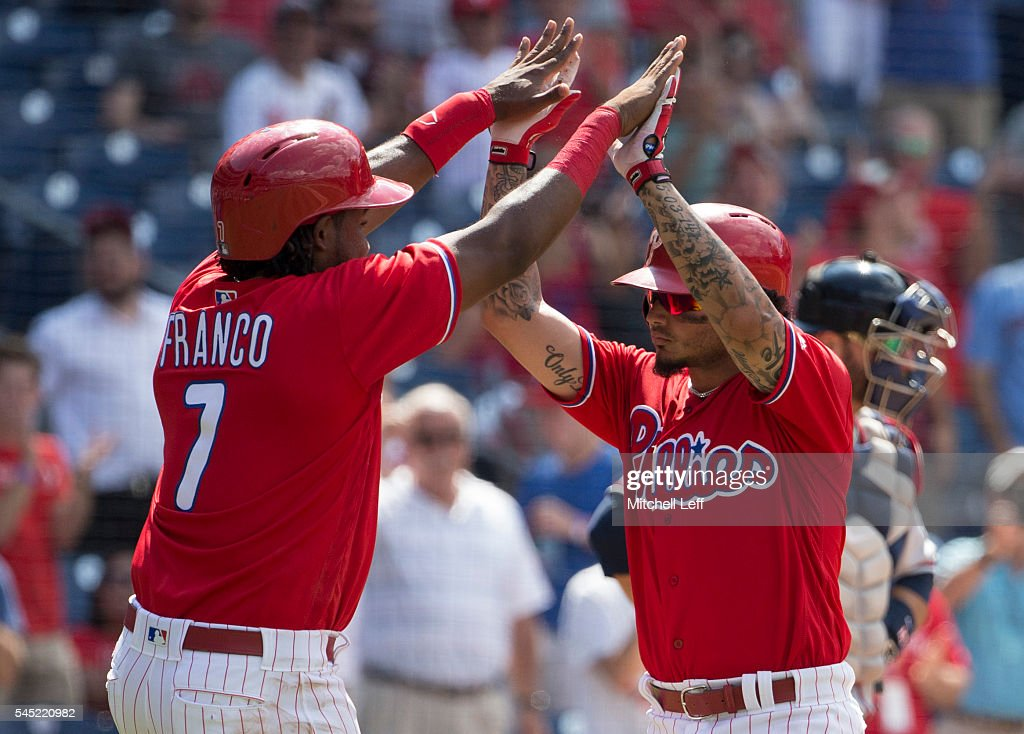 Maikel Franco #7 of the Philadelphia Phillies high fives Freddy Galvis #13 after a two run home run hit by Galvis in the bottom of the eighth inning against the Atlanta Braves at Citizens Bank Park on July 6, 2016 in Philadelphia, Pennsylvania. The Phillies defeated the Braves 4-3.