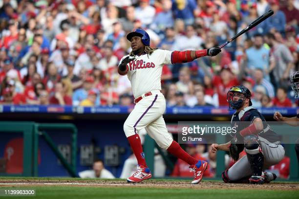 Maikel Franco of the Philadelphia Phillies hits a home run against the Atlanta Braves at Citizens Bank Park on March 30 2019 in Philadelphia...