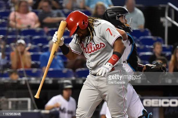 Maikel Franco of the Philadelphia Phillies hits his helmet with his bat after striking out in the second inning against the Miami Marlins at Marlins...