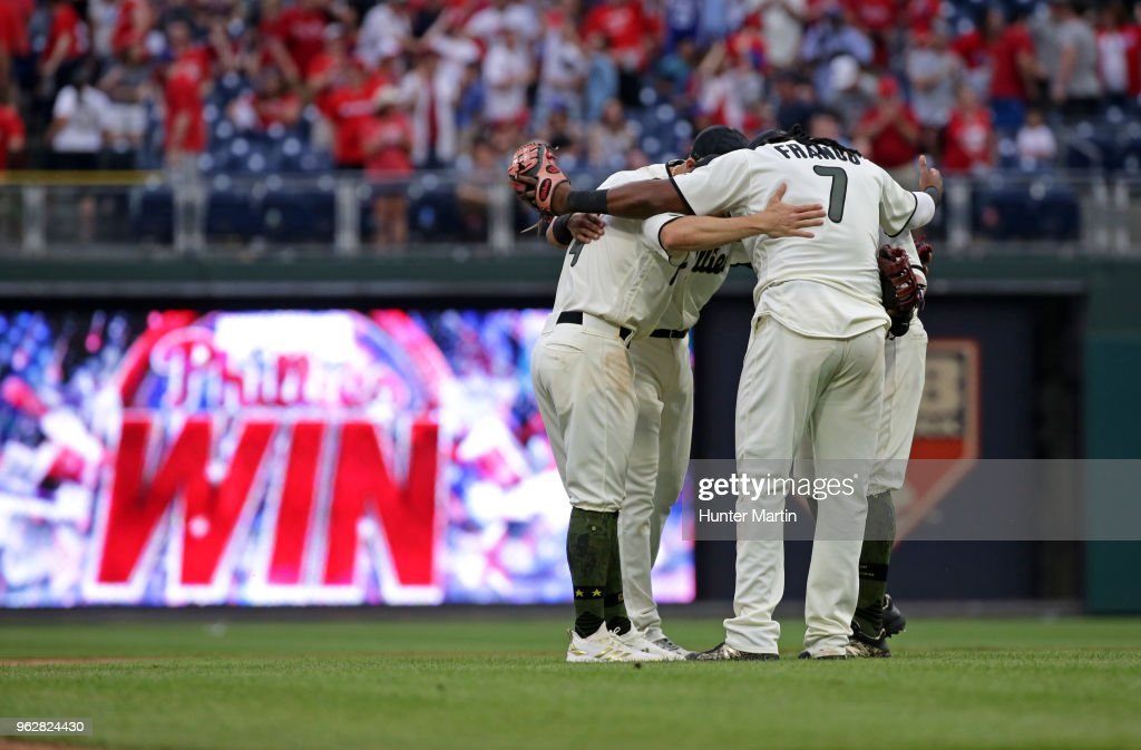 Maikel Franco #7 of the Philadelphia Phillies hugs teammates after winning a game against the Toronto Blue Jays at Citizens Bank Park on May 26, 2018 in Philadelphia, Pennsylvania. The Phillies won 2-1.