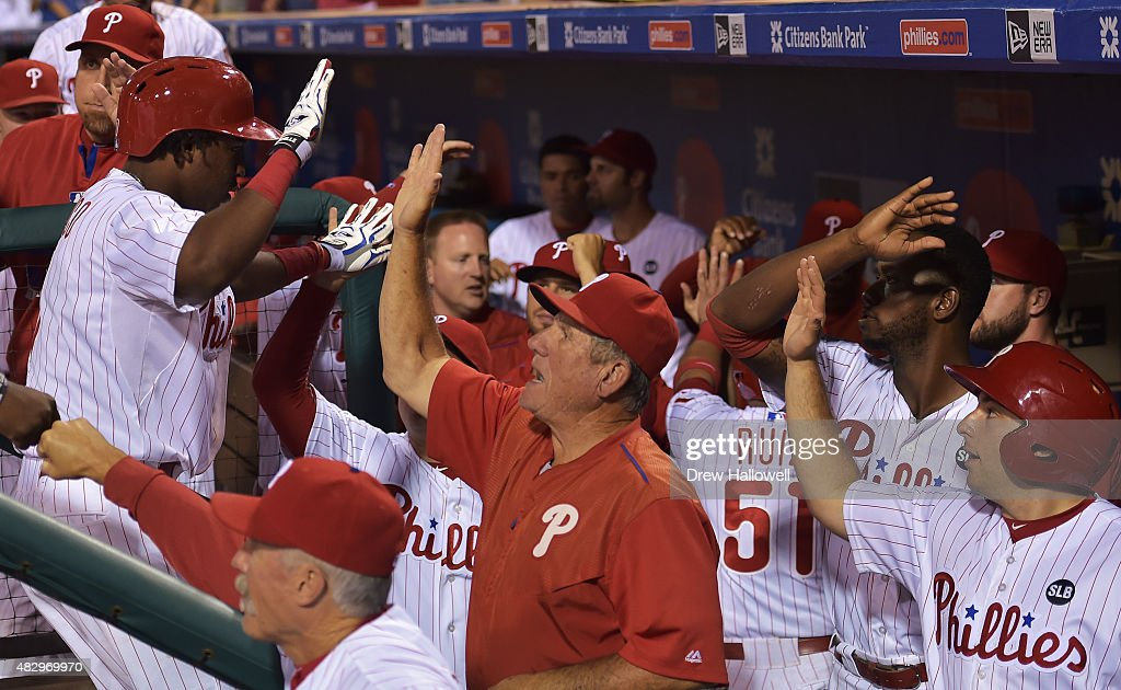 Maikel Franco #7 of the Philadelphia Phillies is congratulated by teammates and coaches after hitting a grand slam in the seventh inning against the Los Angeles Dodgers at Citizens Bank Park on August 4, 2015 in Philadelphia, Pennsylvania.