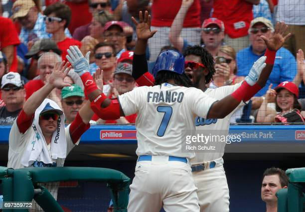Maikel Franco of the Philadelphia Phillies is congratulated by Odubel Herrera and Andrew Knapp after hitting a home run against the Arizona...