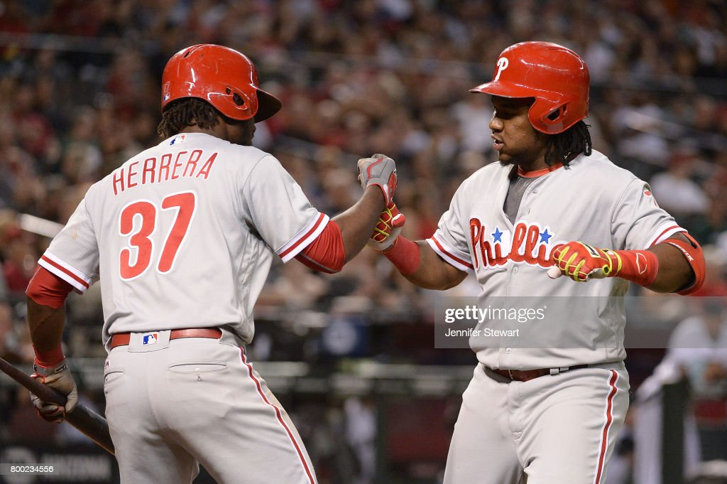 Maikel Franco #7 of the Philadelphia Phillies is congratulated by Odubel Herrera #37 after hitting a solo home run in the eighth inning of the MLB game against the Arizona Diamondbacks at Chase Field on June 23, 2017 in Phoenix, Arizona.