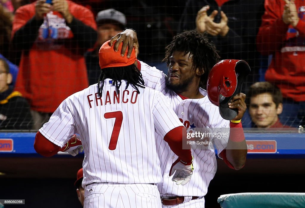 Maikel Franco #7 of the Philadelphia Phillies is congratulated by Odubel Herrera #37 after he hit a home run during the second inning of a game against the New York Mets at Citizens Bank Park on September 30, 2017 in Philadelphia, Pennsylvania.
