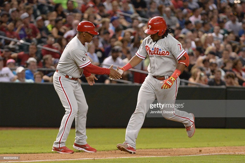 Maikel Franco #7 of the Philadelphia Phillies is congratulated by third base coach Juan Samuel #8 after hitting a solo home run in the eighth inning of the MLB game against the Arizona Diamondbacks at Chase Field on June 23, 2017 in Phoenix, Arizona.