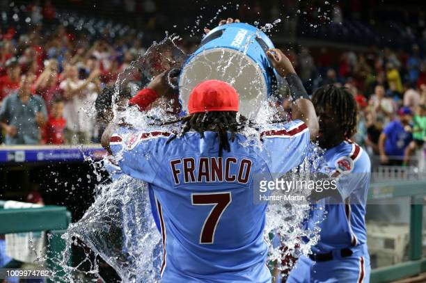 Maikel Franco of the Philadelphia Phillies is dosed with water after hitting a game winning walkoff threerun home run in the ninth inning during a...