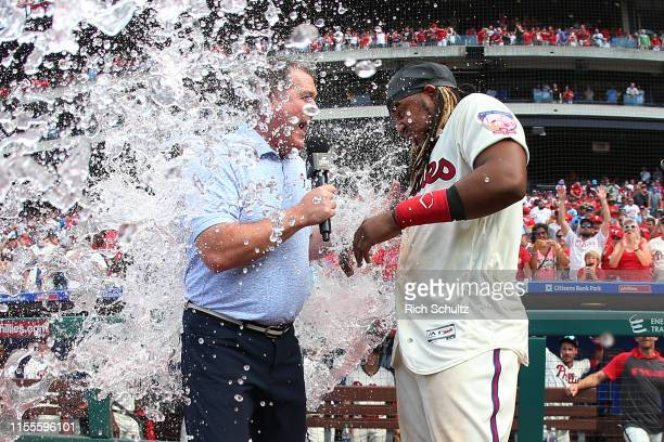 Maikel Franco of the Philadelphia Phillies is doused with water while being interviewed by Greg Murphy of NBCSN after hitting the game winning...