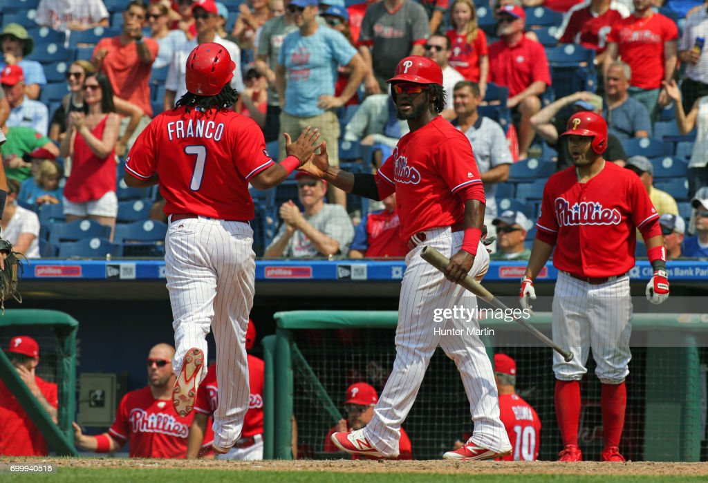 Maikel Franco #7 of the Philadelphia Phillies is greeted at home plate by Odubel Herrera #37 after scoring a run in the eighth inning during a game against the St. Louis Cardinals at Citizens Bank Park on June 22, 2017 in Philadelphia, Pennsylvania. The Phillies won 5-1.