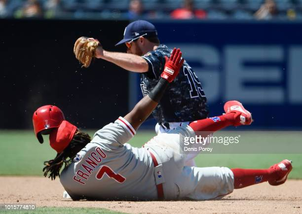 Maikel Franco of the Philadelphia Phillies is tagged out at second base by Cory Spangenberg of the San Diego Padres as he tries to stretch a single...