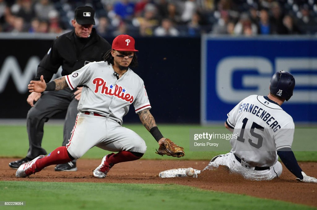 Maikel Franco #7 of the Philadelphia Phillies loses the ball as Cory Spangenberg #15 of the San Diego Padres steals second base during the fifth inning of a baseball game at PETCO Park on August 15, 2017 in San Diego, California.