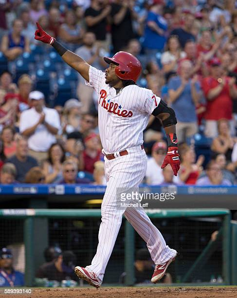 Maikel Franco of the Philadelphia Phillies reacts after hitting a three run home run in the bottom of the first inning against the Colorado Rockies...