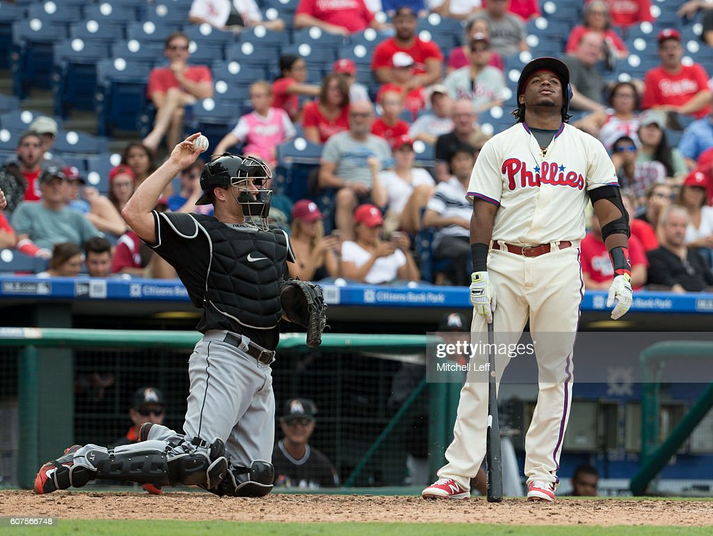 Maikel Franco #7 of the Philadelphia Phillies reacts in front of J.T. Realmuto #11 of the Miami Marlins after striking out in the bottom of the eighth inning at Citizens Bank Park on September 18, 2016 in Philadelphia, Pennsylvania. The Marlins defeated the Phillies 5-4.