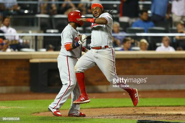 Maikel Franco of the Philadelphia Phillies scores on a threerun double off the bat of Aaron Nola in the fifth inning against the New York Mets during...